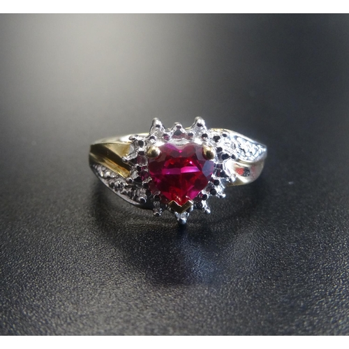 25 - SYNTHETIC RUBY AND DIAMOND CLUSTER DRESS RING the central heart cut ruby in textured surround set wi...