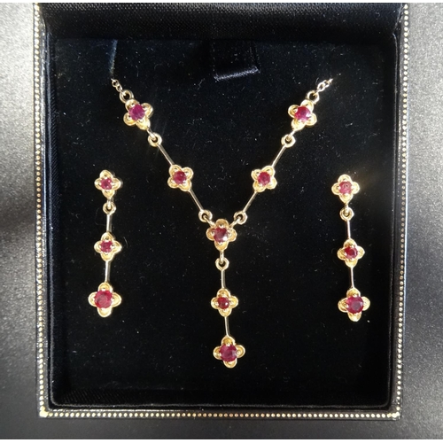 27 - ATTRACTIVE RUBY SET NECKLACE AND MATCHING DROP EARRINGS all in nine carat gold, the necklace with ru...