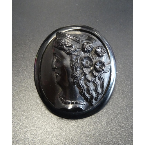 30 - CARVED JET BROOCH depicting a female bust in profile, 4.3cm high  -  RE-OFFERED TIMED AUCTION...