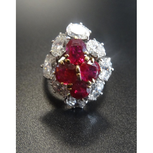 34 - OUTSTANDING RUBY AND DIAMOND CLUSTER RING the central ruby cluster formed with four oval cut stones ...