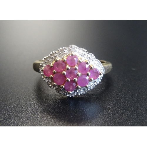 40 - RUBY AND DIAMOND CLUSTER RING the central lozenge shaped ruby cluster in textured surround set with ...