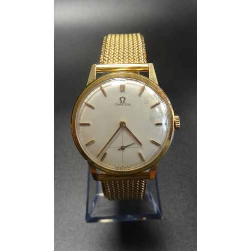 45 - GENTLEMAN'S VINTAGE EIGHTEEN CARAT GOLD CASED OMEGA WRISTWATCH the circular dial with baton hour mar...