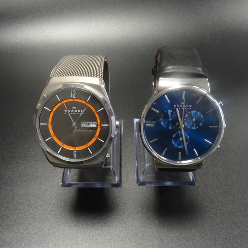 46 - TWO GENTLEMEN'S SKAGEN WRISTWATCHES one with blue dial, model number SKW6105; the other with silver ...