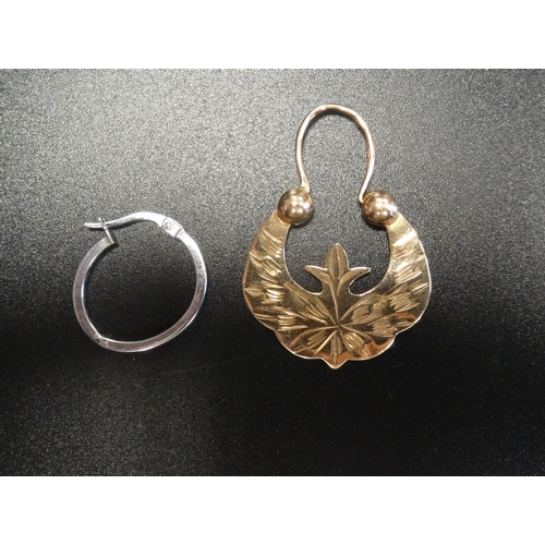 124 - SINGLE FOURTEEN CARAT ROSE GOLD EARRING approximately 2.7 grams; together with a single nine carat w...