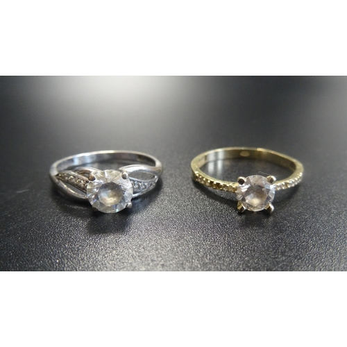 127 - TWO CZ SET RINGS one on fourteen carat gold shank, ring size P; the other in nine carat white gold w...