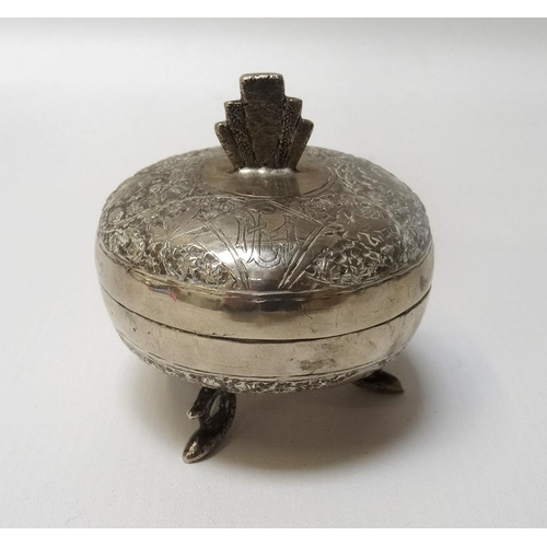 187 - EASTERN SILVER DISH AND COVER with engraved floral decoration and raised on three shaped feet, 6.4cm...