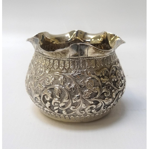 191 - EASTERN SILVER BOWL with frilly rim, the body decorated with floral/foliate scrolls, 5.8cm high and ...