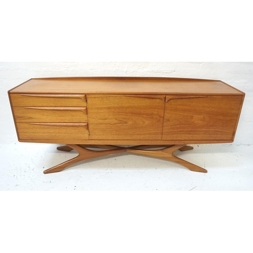 560 - BEITHCRAFT TEAK SIDEBOARD the shaped raised back above an oblong top, with three drawers below and a...