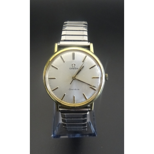 142 - 1960s GENTLEMAN'S 'OMEGA' WRISTWATCH with expanding bracelet strap, foreign inscription to backplate...
