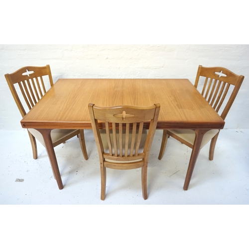 561 - TEAK EXTENDING DINING TABLE the pull apart top revealing a fold out leaf, standing on turned taperin...