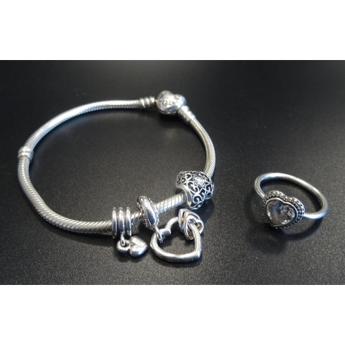 2 - PANDORA MOMENTS SILVER CHARM BRACELET with three Pandora charms; together with a Pandora Sparkling H...