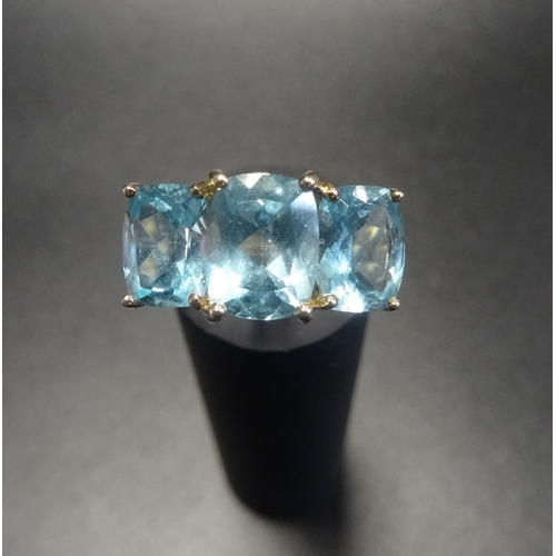 8 - AQUAMARINE THREE STONE RING the three oval cut aquamarines on nine carat gold shank, ring size P - R...