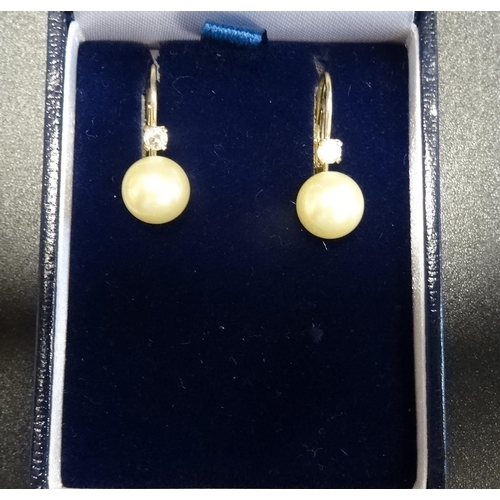 13 - PAIR OF DIAMOND AND SIMULATED PEARL EARRINGS in fourteen carat gold - FOR RETURN...