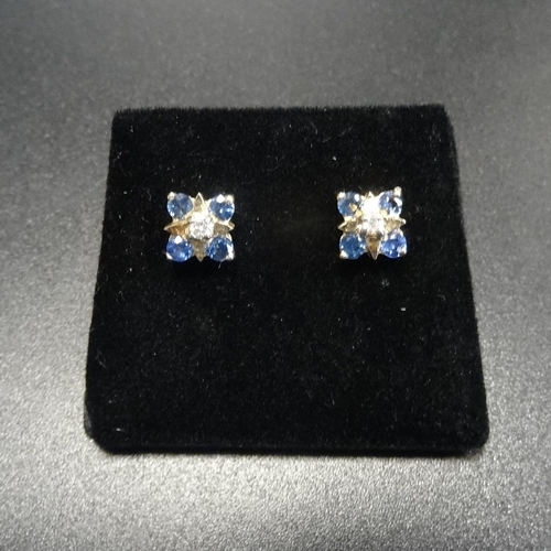 26 - PAIR OF SAPPHIRE AND DIAMOND CLUSTER STUD EARRINGS the central diamond on each in square setting wit...