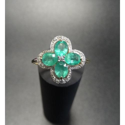 36 - EMERALD AND DIAMOND CLUSTER RING the four oval cut emeralds in diamond set quatrefoil surround, on n...