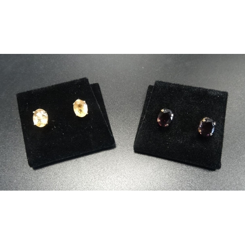 52 - TWO PAIRS OF OVAL CUT GEM SET STUD EARRINGS one pair possibly peach/yellow sapphires, the other garn...