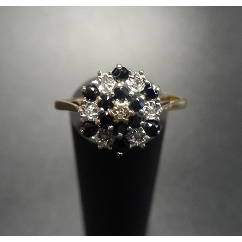 56 - SAPPHIRE AND DIAMOND CLUSTER RING in nine carat gold with stepped setting, ring size S-T...