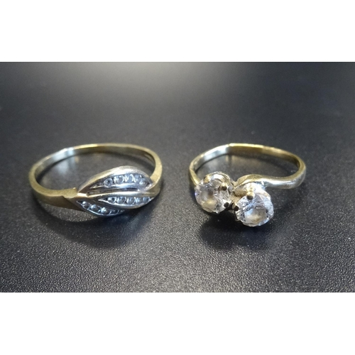 59 - TWO CZ SET GOLD RINGS one a two stone twist design ring on nine carat gold shank, the other in Polis...