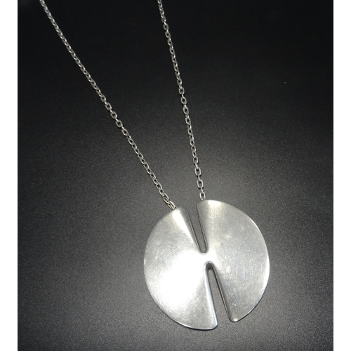 9 - 1970s GEORG JENSEN SILVER PENDANT ON CHAIN  to a design by Nanna Ditzel, the circular pendant with s...