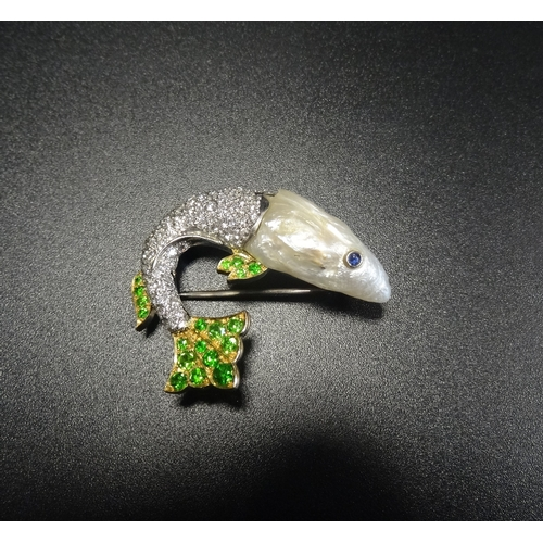 47 - UNUSUAL DIAMOND, GREEN GEM AND PEARL SET FISH BROOCH the baroque pearl head set with sapphire eye, t...