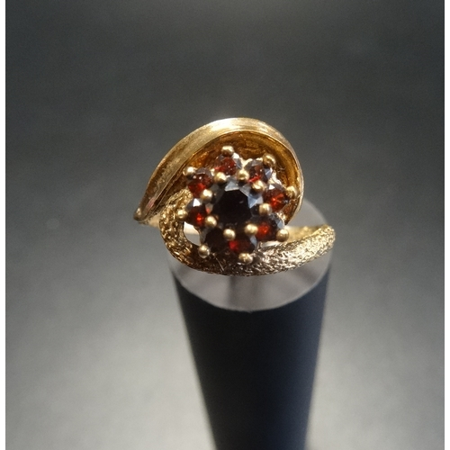 5 - GARNET CLUSTER RING on nine carat gold shank with twist setting, ring size L-M...