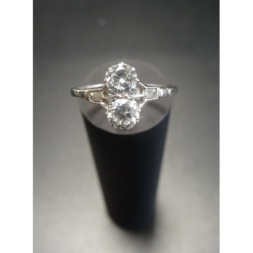 22 - DIAMOND TWO STONE RING the diamonds in unusual vertical setting totalling approximately 0.6cts, on p...