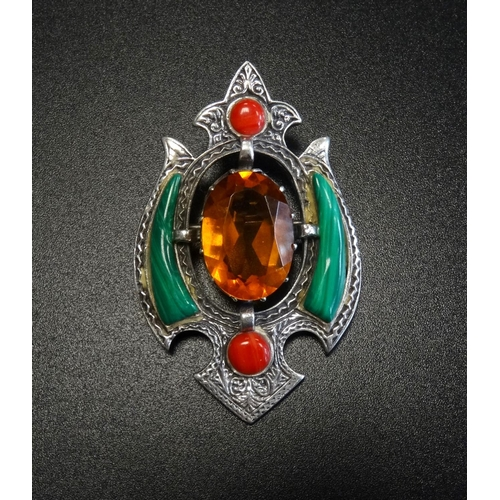 36 - SILVER AND STONE SET BROOCH the central oval cut Cairngorm with malachite and carnelian set surround...