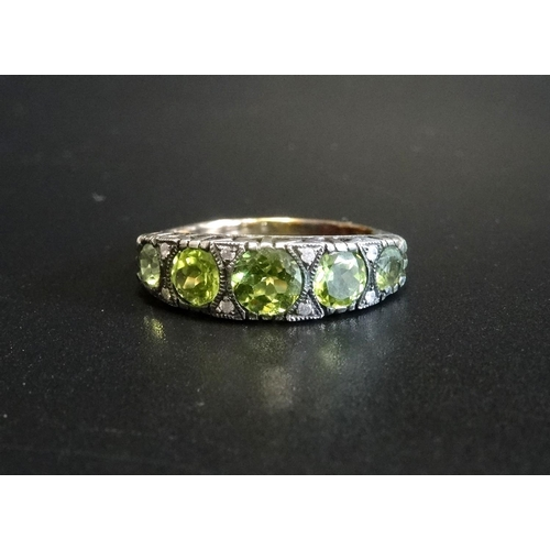 53 - GRADUATED PERIDOT FIVE STONE RING on fifteen carat gold shank with silver setting, ring size M-N - R...