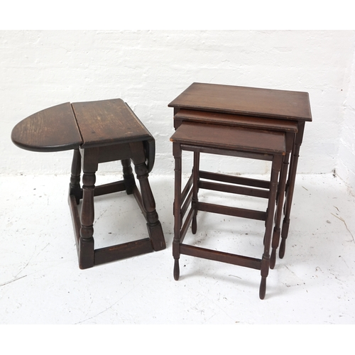 420 - NEST OF THREE MAHOGANY OCCASIONAL TABLES with oblong tops and standing on turned supports united by ...