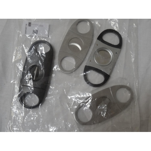 38 - SELECTION OF FOUR NEW AND USED CIGAR CUTTERS Note: You must be over 18 years of age to bid on this l...