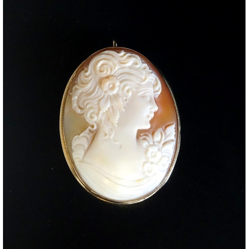 67 - SHELL CAMEO BROOCH PENDANT depicting a young woman in profile, in nine carat gold mount, 4.1cm high...