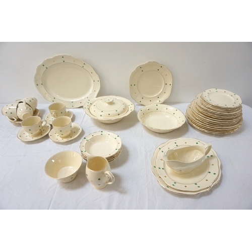 188 - BRITISH DINNER AND COFFEE SERVICE decorated with green and gilt spots on a cream ground with gilt bo...
