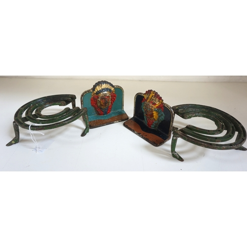 258 - PAIR OF CAST IRON NOVELTY BOOKENDS modelled as native Americans, brightly decorated and wearing head...