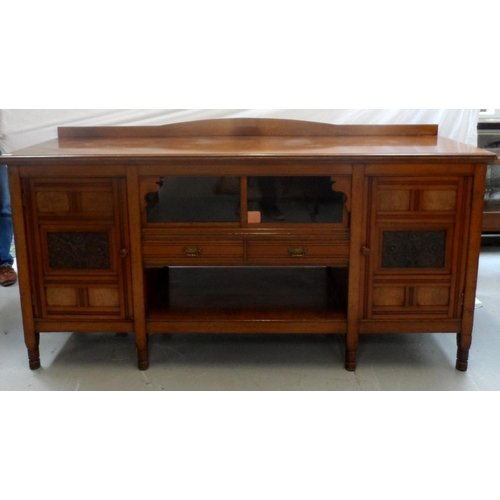 489 - EDWARDIAN OAK SIDE CABINET with a replaced shaped and raised back above a moulded top with a pair of...