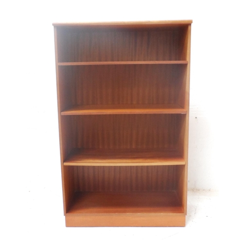 492 - TEAK OPEN BOOKCASE with a moulded top above four shelves, standing on a plinth base, 132cm x 81cm - ...