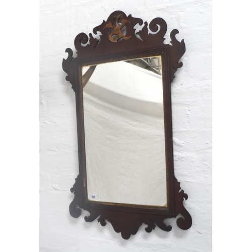 493 - GEORGE III STYLE MAHOGANY FRET CARVED WALL MIRROR surmounted with a giltwood griffen, 88cm high, tog...