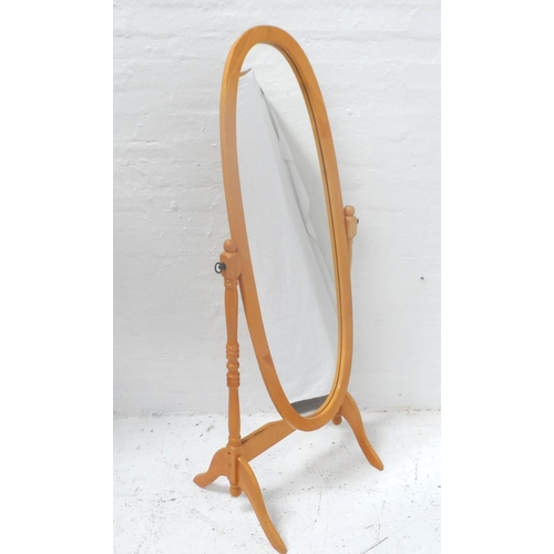 495 - OVAL BEECH CHEVAL MIRROR supported by turned arms and standing on splayed supports, 155cm high...
