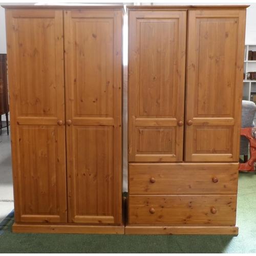 542 - WAXED PINE BEDROOM SUITE comprising a two panelled door wardrobe, 179cm x 90cm, a panelled two door ...