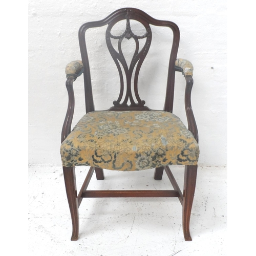 543 - MAHOGANY ARMCHAIR with a shaped back and a shaped and pierced splat with husk decoration, the part p...