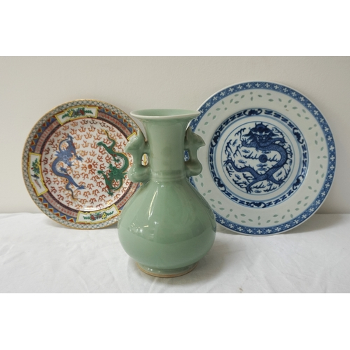 186 - CHINESE CELADON VASE with a flared rim and pierced side handles, 17cm high, a blue and white plate d...