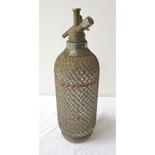 198 - VINTAGE GLASS SODA SYPHON overlaid with a metal wirework lattice, 34.5cm high - RE-OFFERED IN TIMED ...