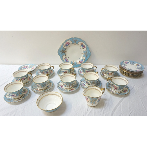 199 - PARAGON TEA SERVICE the pale blue and white ground decorated with flowers and signed to the undersid...