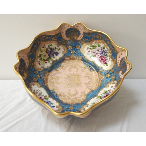 201 - ROYAL DOULTON CENTRE BOWL raised on a shaped foot, of irregular form with a gilt rim to the blue and...