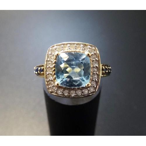 8 - AQUAMARINE, DIAMOND AND SAPPHIRE DRESS RING the central cushion cut aquamarine in diamond surround a...