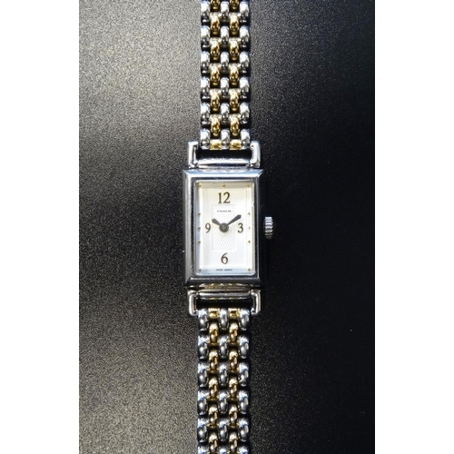 38 - LADIES COACH WRISTWATCH the rectangular dial with Arabic numerals at 3, 6, 9 and 12, and with furthe...