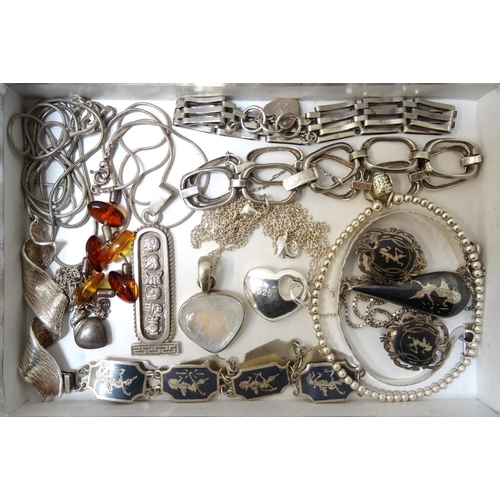 41 - GOOD SELECTION OF SILVER JEWELLERY including an amber set necklace, an Egyptian style hieroglyph dec...