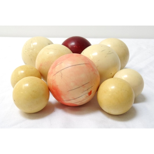 266 - TEN CHINESE IVORY BALLS of varying size and some stained (10)...