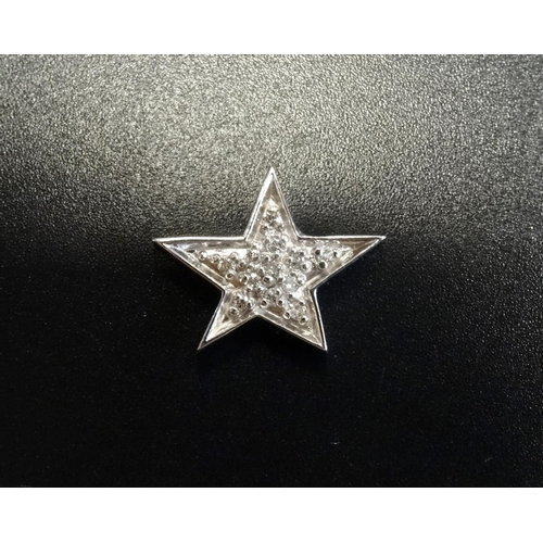 92 - DIAMOND SET STAR SHAPED PENDANT the pave set diamond in unmarked white gold - RE-OFFERED IN TIMED AU...