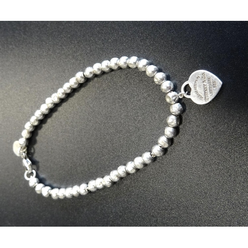 3 - TIFFANY & CO. MINI HEART TAG SILVER BEAD BRACELET the heart tag with 'Return to Tiffany' engraving t...