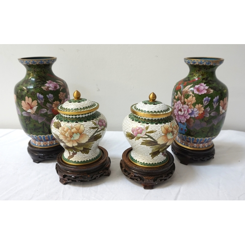 253 - PAIR OF CHINESE CLOISONNE VASES with a dark green ground decorated with a basket of flowers, on a ci...